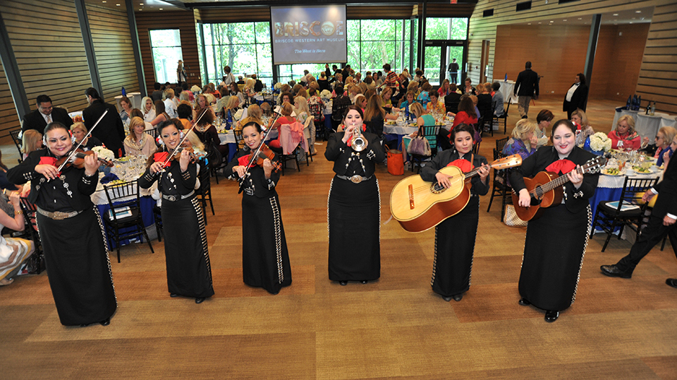 Female mariachi band performs at an event